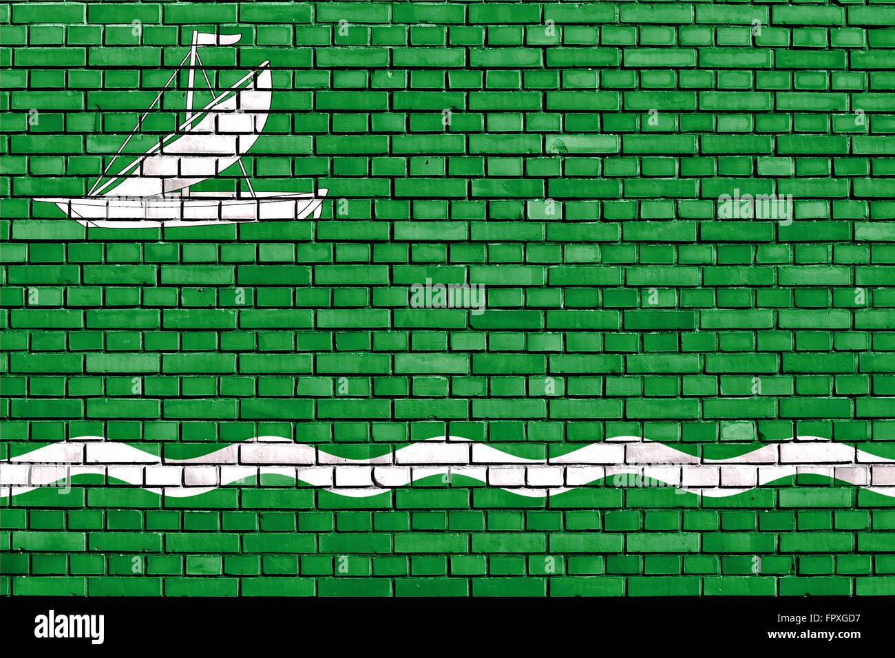 flag of Vilanova de la Barca painted on brick wall - Stock Image