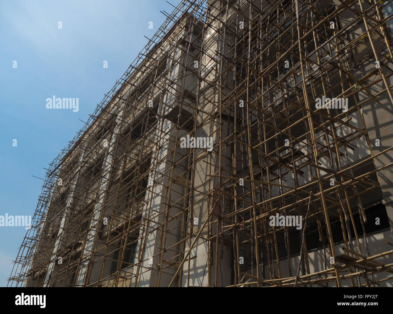 Construction building with bamboo scaffolding, Thailand - Stock Image