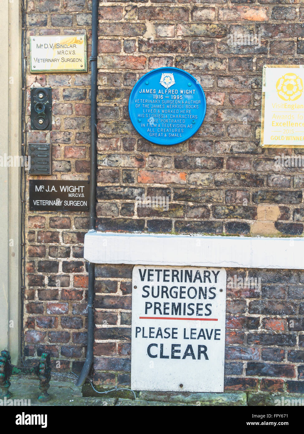 Signs at the door of the James Herriot museum formerly the veterinary practice of author Alf Wight - Stock Image