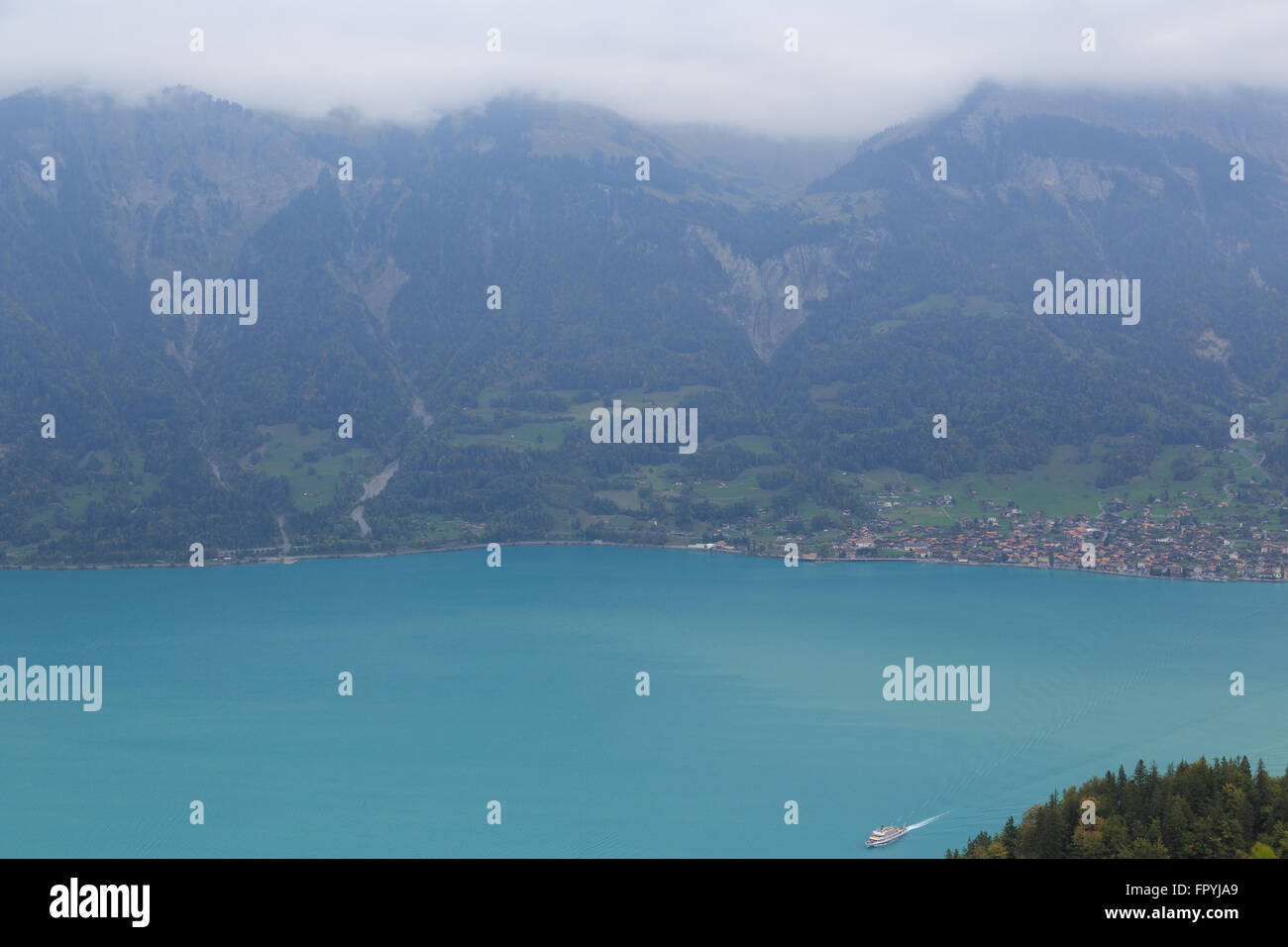 A landscape photograph of a passenger ferry on Lake Brienz in Switzerland. Stock Photo
