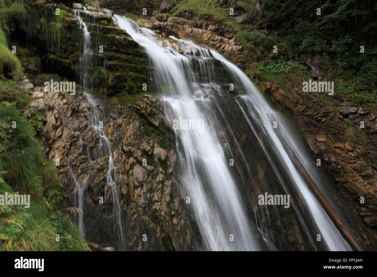 A photograph of Giessbach Falls on Lake Brienz in the Bernese Oberland area of Switzerland. Stock Photo