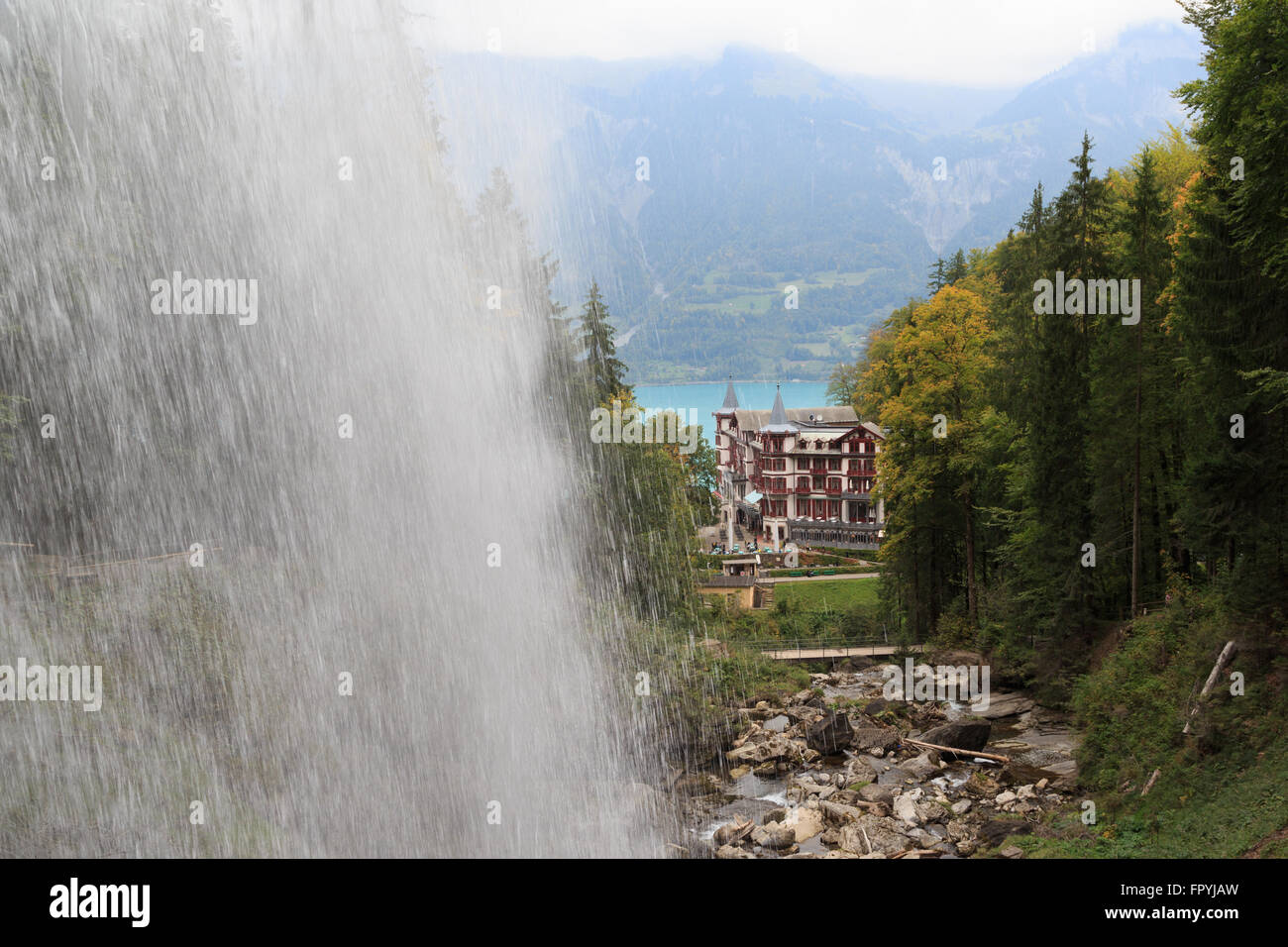 A photograph of the Grand Hotel Giessbach as seen from behind the Giessbach Falls on Lake Brienz in Switzerland. Stock Photo