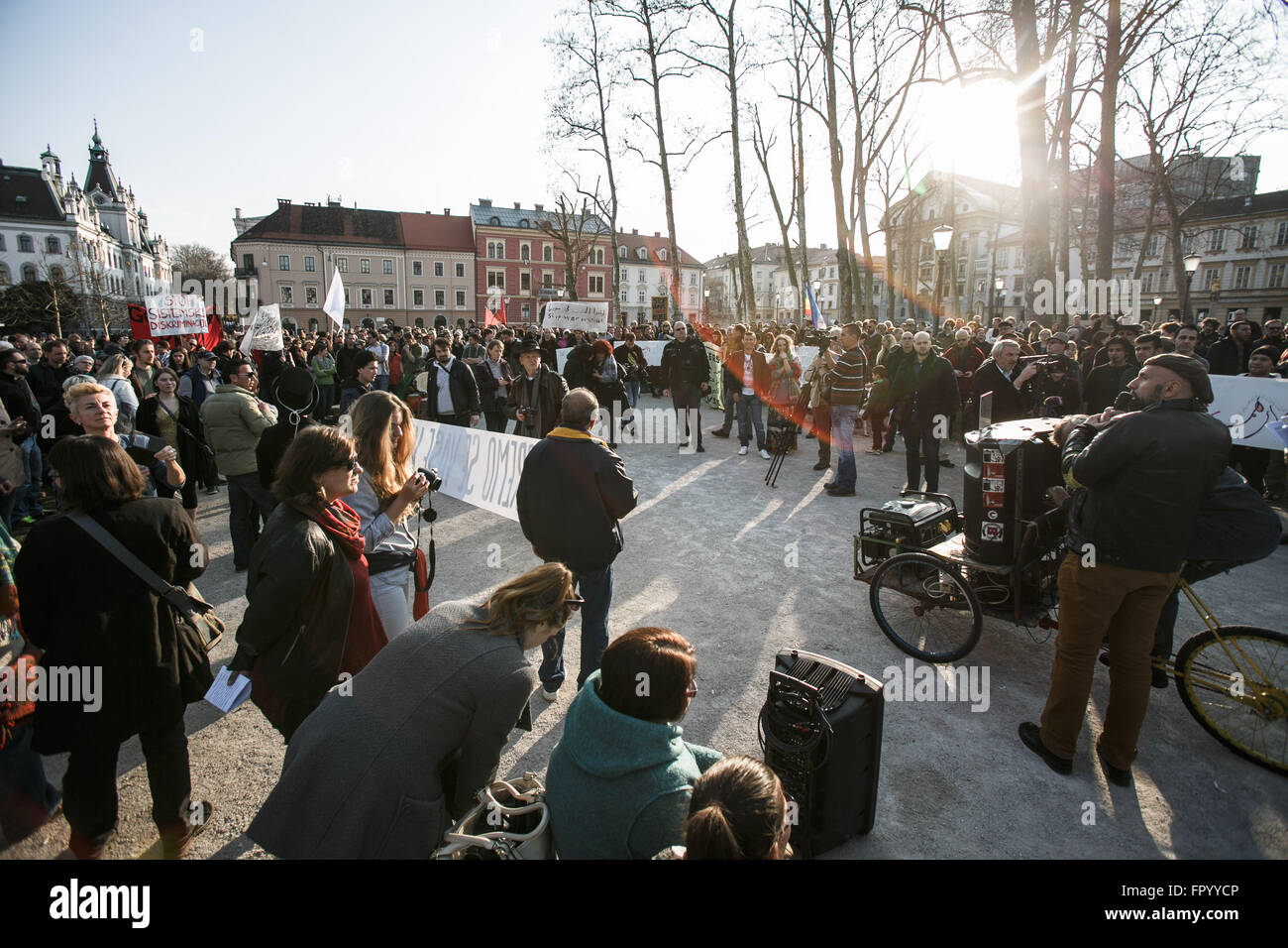 Ljubljana, Slovenia. 19th Mar, 2016. Protesters listen to speeches in Zvezda Park during a protest against racism - Stock Image