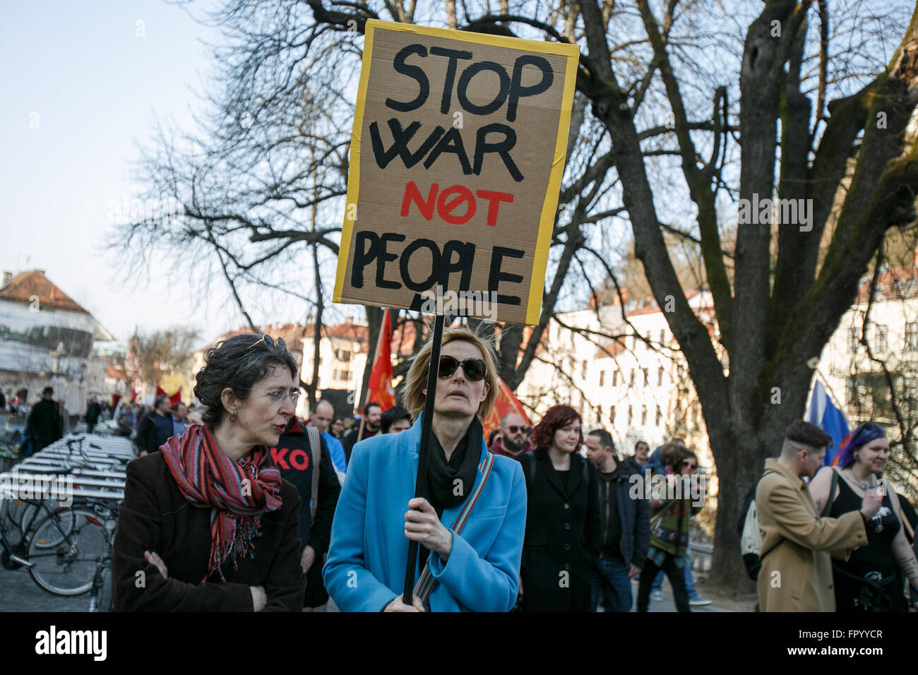 Ljubljana, Slovenia. 19th Mar, 2016. A protester carries a banner during a protest against racism and fascism in - Stock Image