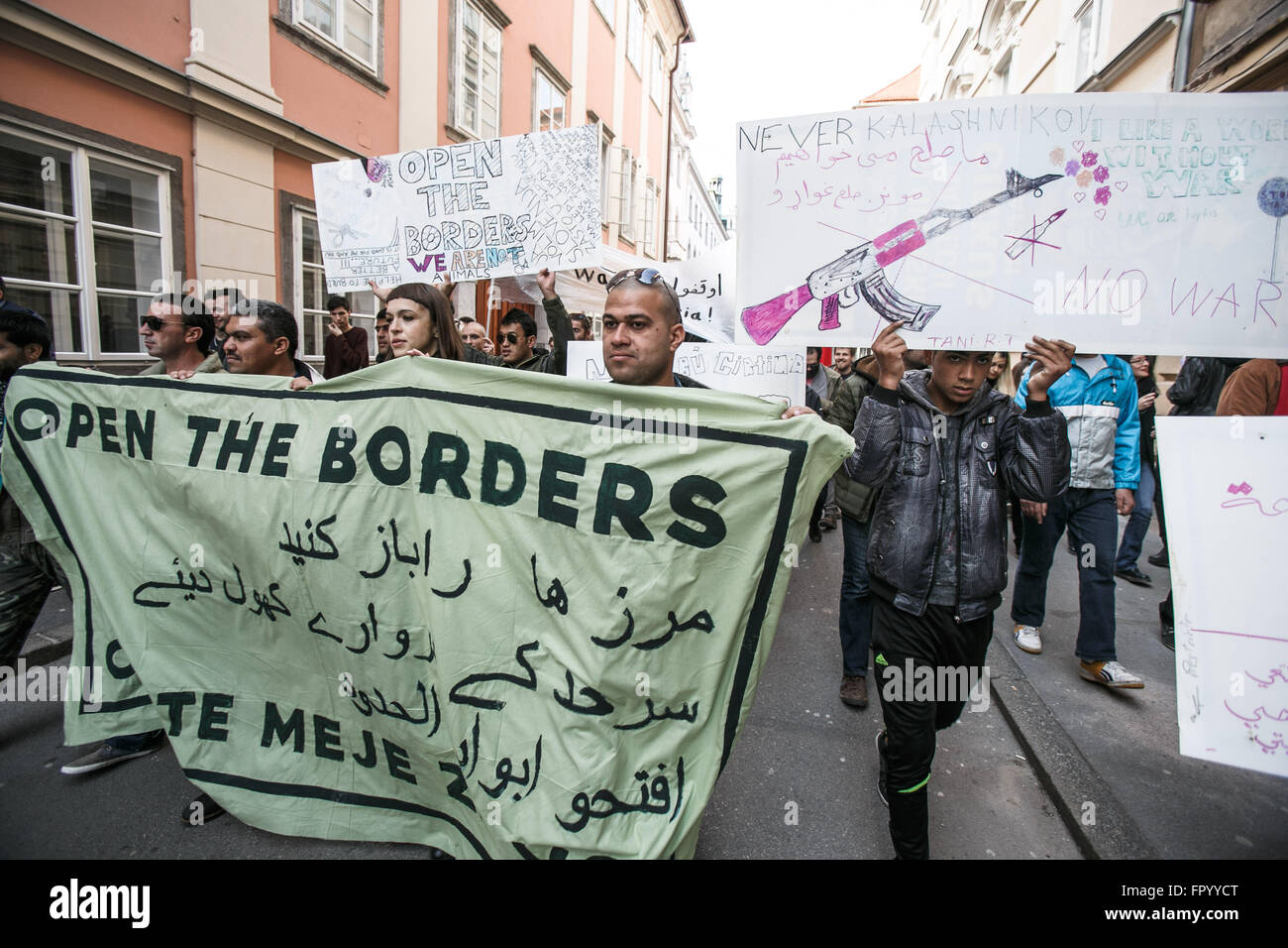 Ljubljana, Slovenia. 19th Mar, 2016. Protesters carry banners during a protest against racism and fascism in Ljubljana, - Stock Image
