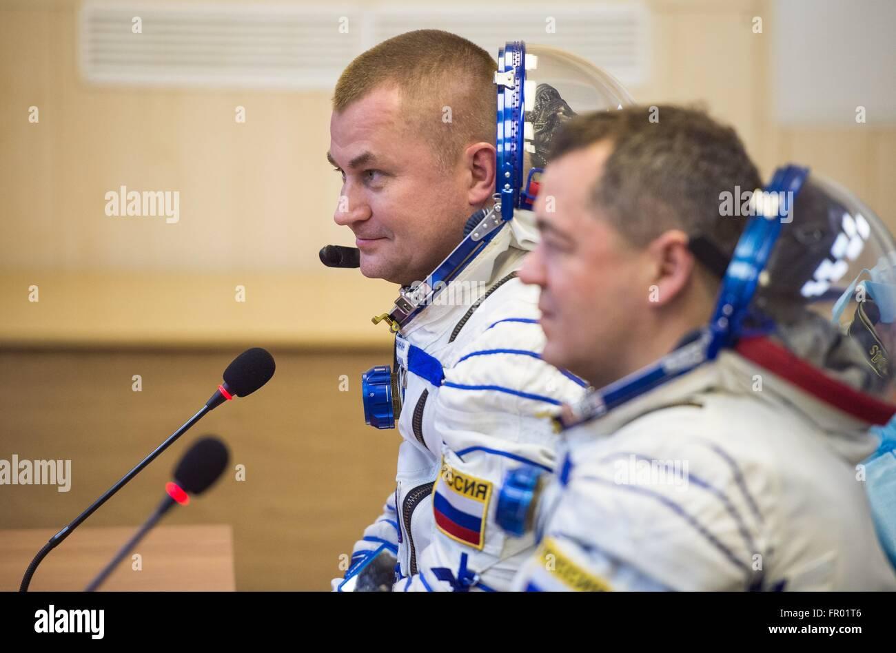 Baikonur, Kazakhstan. 19th Mar, 2016. Russian Soyuz Commander Alexey Ovchinin speaks with family after having his - Stock Image