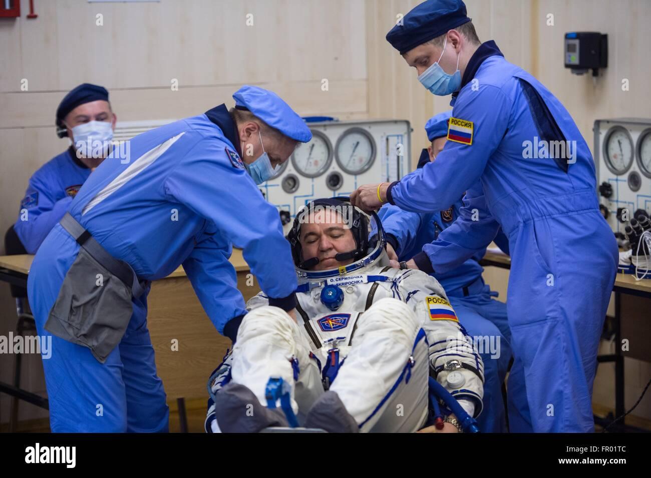 Baikonur, Kazakhstan. 19th Mar, 2016. Russian cosmonaut Oleg Skripochka during final pressure checks on his Russian - Stock Image