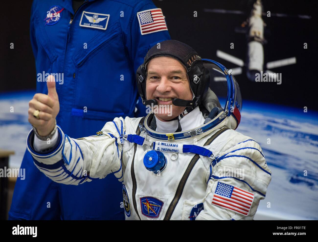 Baikonur, Kazakhstan. 19th Mar, 2016. American astronaut Jeff Williams gives a thumbs up during final pressure checks - Stock Image