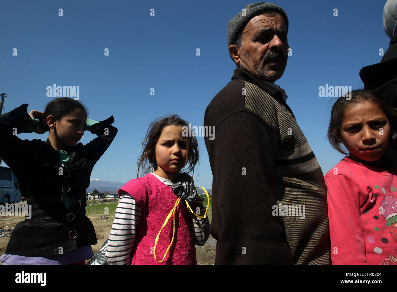 Idomeni. 20th Mar, 2016. Refugees and migrants are seen at the borderline between Greece and the Former Yugoslav - Stock Image