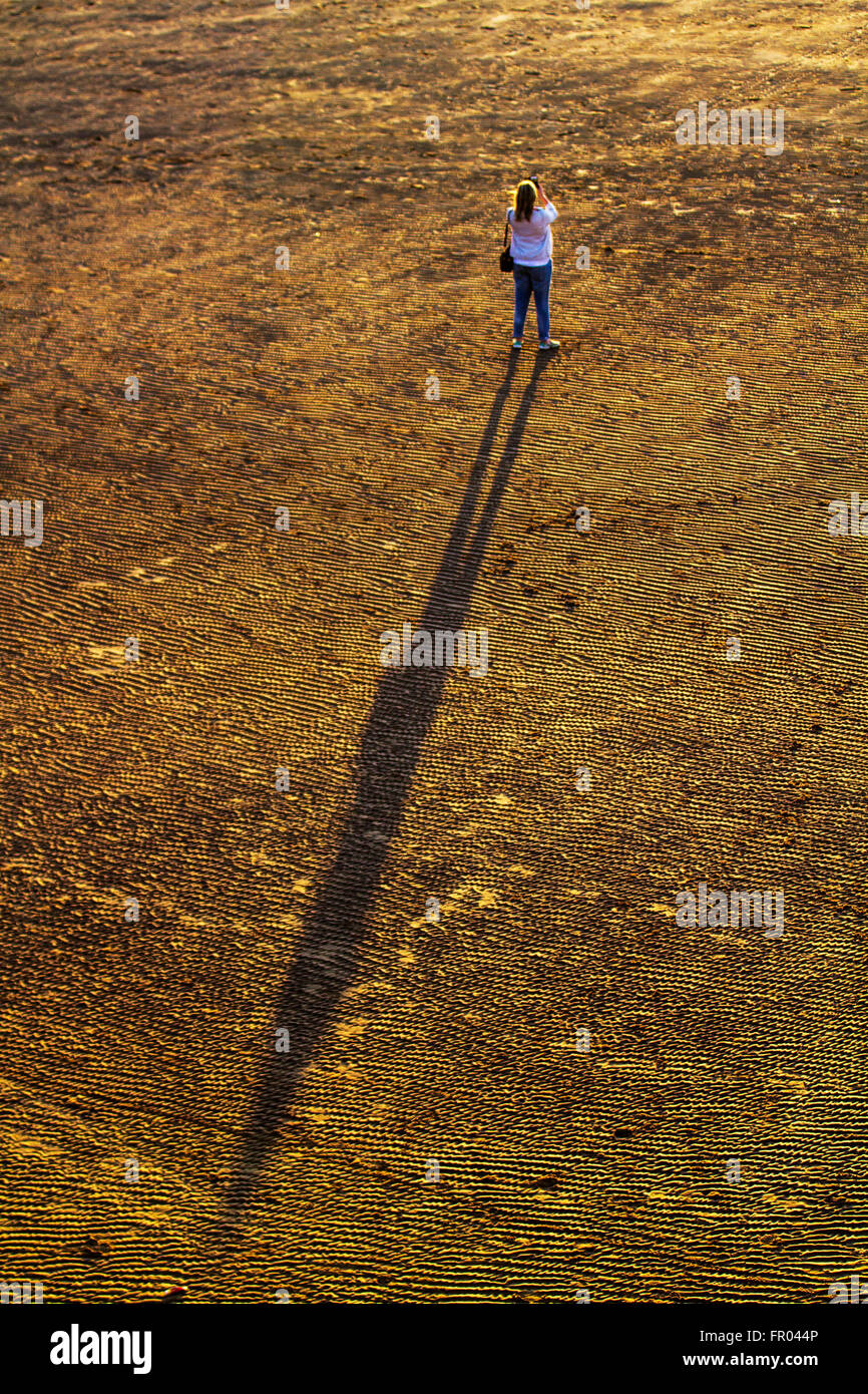 Blackpool, Lancashire, UK 20th March, 2016. UK Weather.  Sunset and Long Shadows. Ripples in sand, found on both - Stock Image