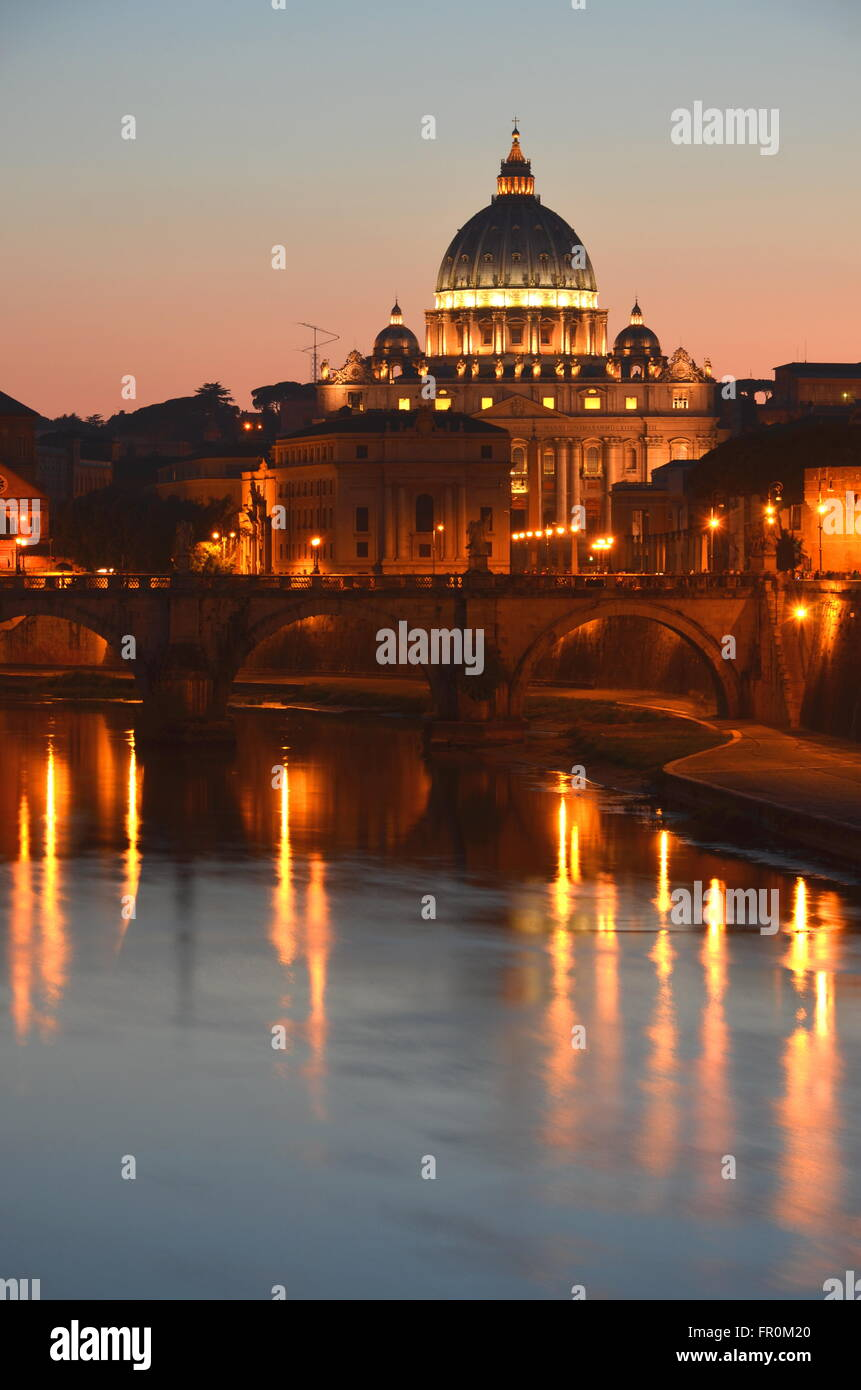 Monumental St. Peters Basilica over Tiber at sunset in Rome, Italy. - Stock Image