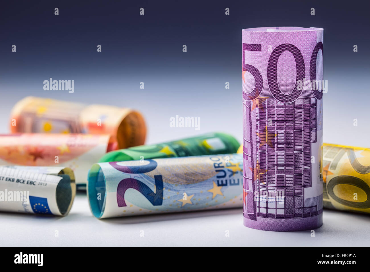 Several hundred euro banknotes stacked by value.Rolls Euro banknotes.Euro currency money.Announced cancellation - Stock Image