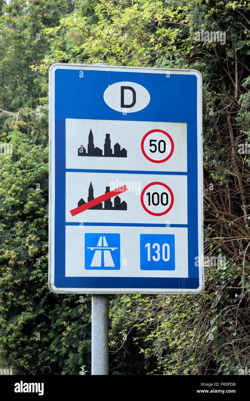 Road side sign indicating speed limits as you enter Germany (from Holland). Stock Photo