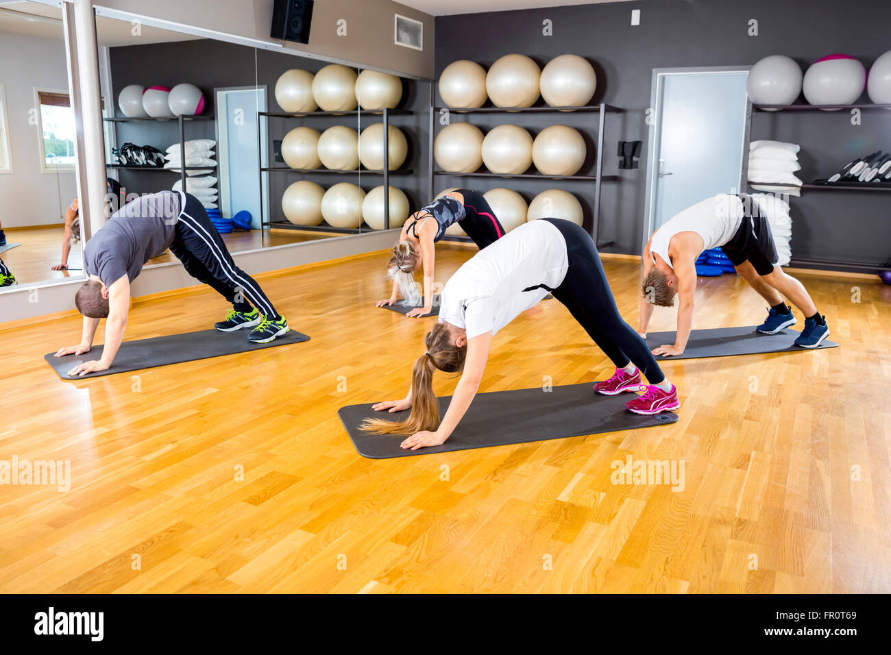 Core Power Yoga Stock Photos Images Alamy Body Gym Pump Warna Group Exercising Flexibility And Balance At Fitness Image