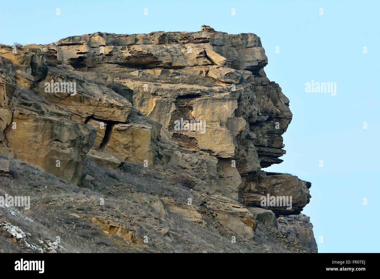 Rock formation shaped like a head. Natural formation resembling an Easter Island head in hills to the west of Baku, - Stock Image