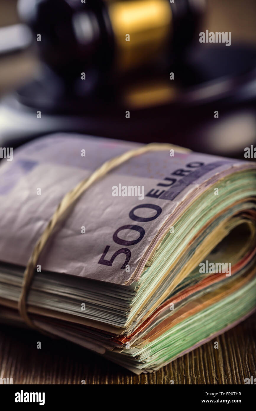 Judge's hammer gavel. Justice and euro money. Euro currency. Court gavel and rolled Euro banknotes. Representation Stock Photo