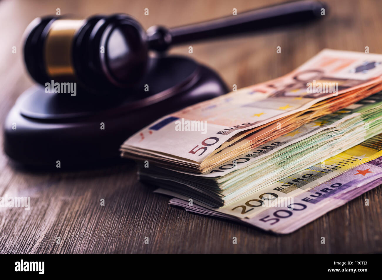 Judge's hammer gavel. Justice and euro money. Euro currency. Court gavel and rolled Euro banknotes. Representation - Stock Image