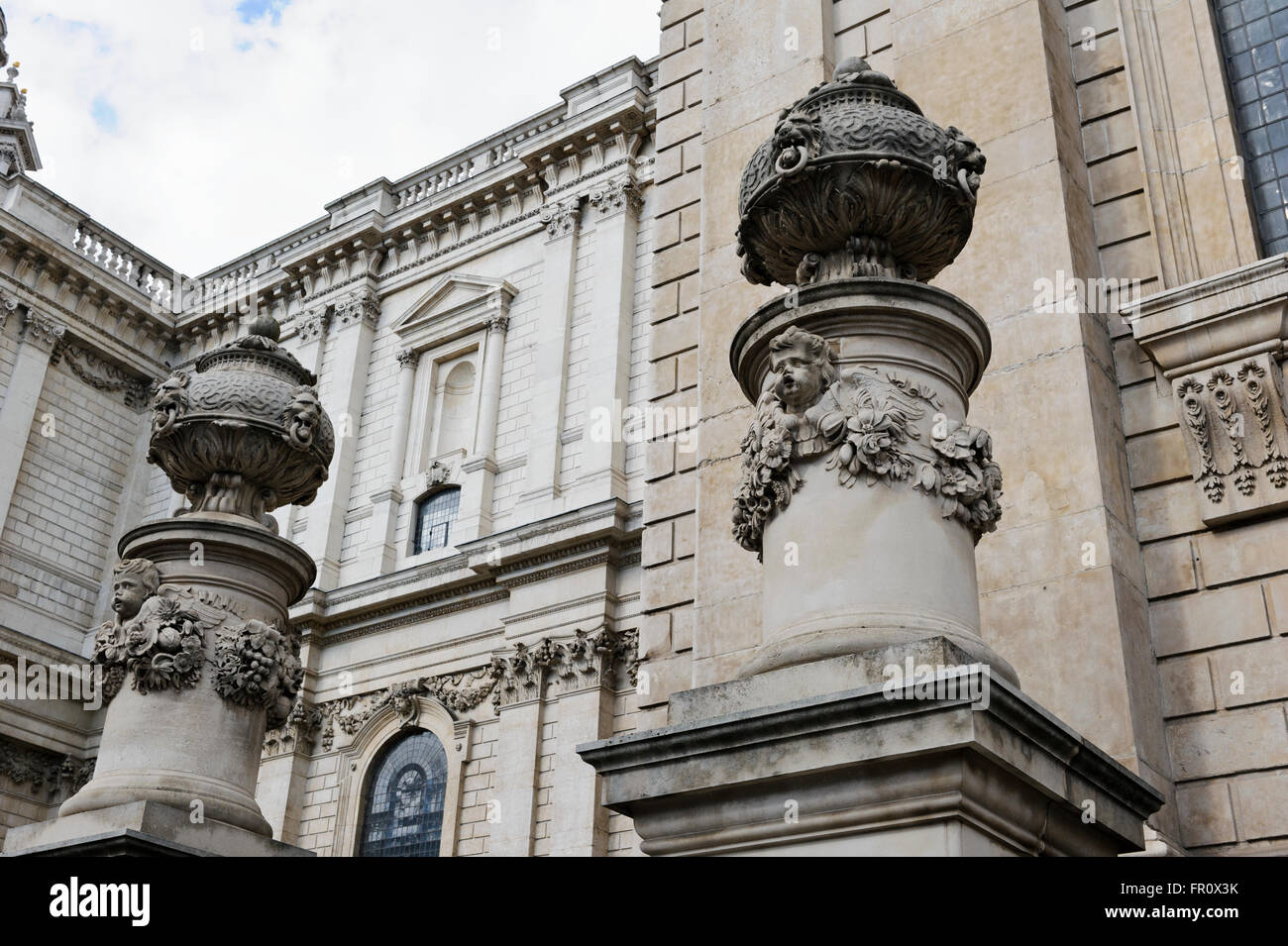 Stone carvings on pillars outside St Paul's Cathedral in London, United Kingdom. - Stock Image