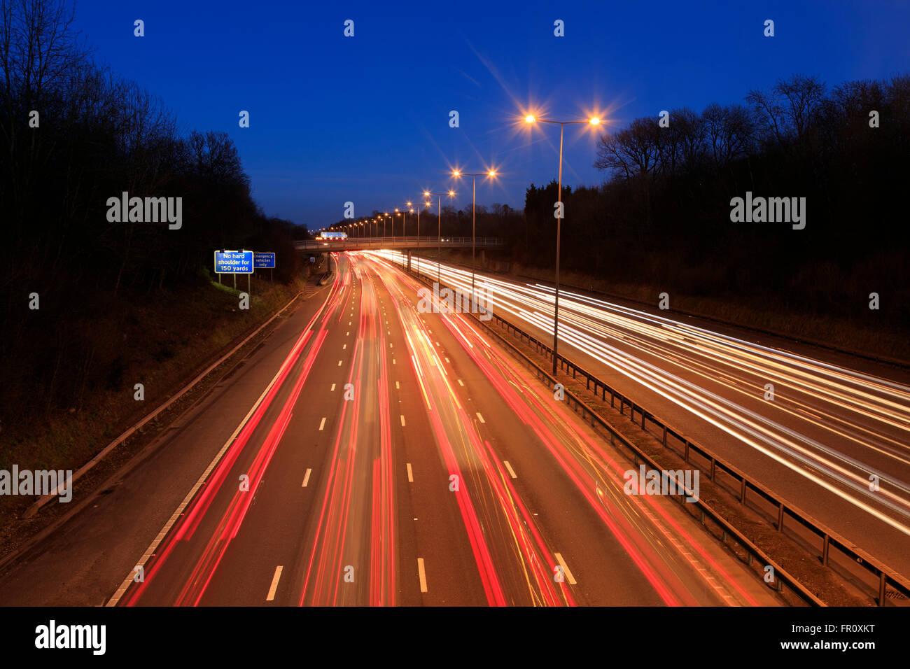 Traffic light trails on M25 [motorway dusk] busy - Stock Image