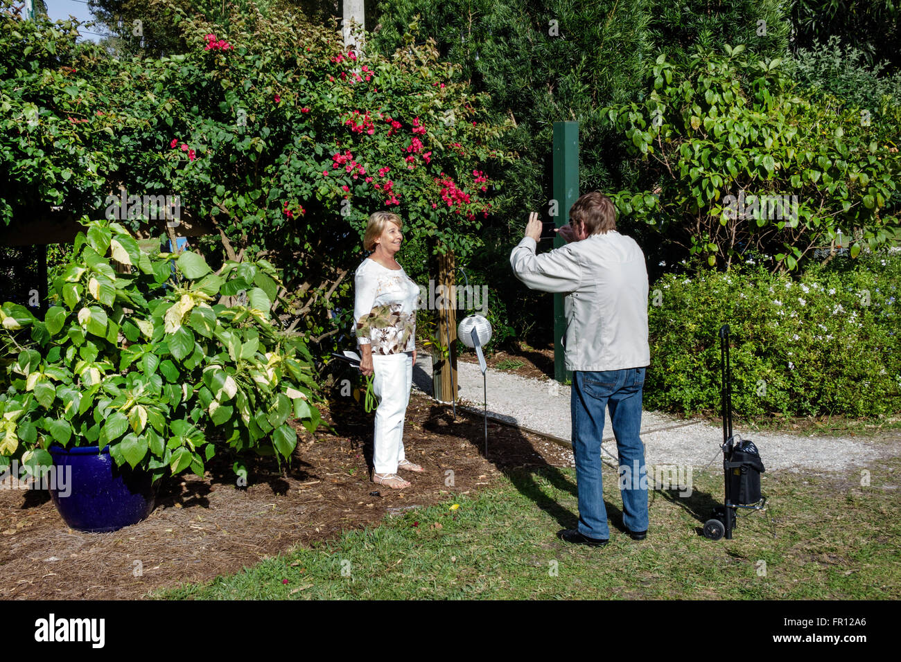 Florida FL Fort Ft. Myers Thomas Edison and Henry Ford Winter Estates historical museum Moonlight Garden man woman - Stock Image