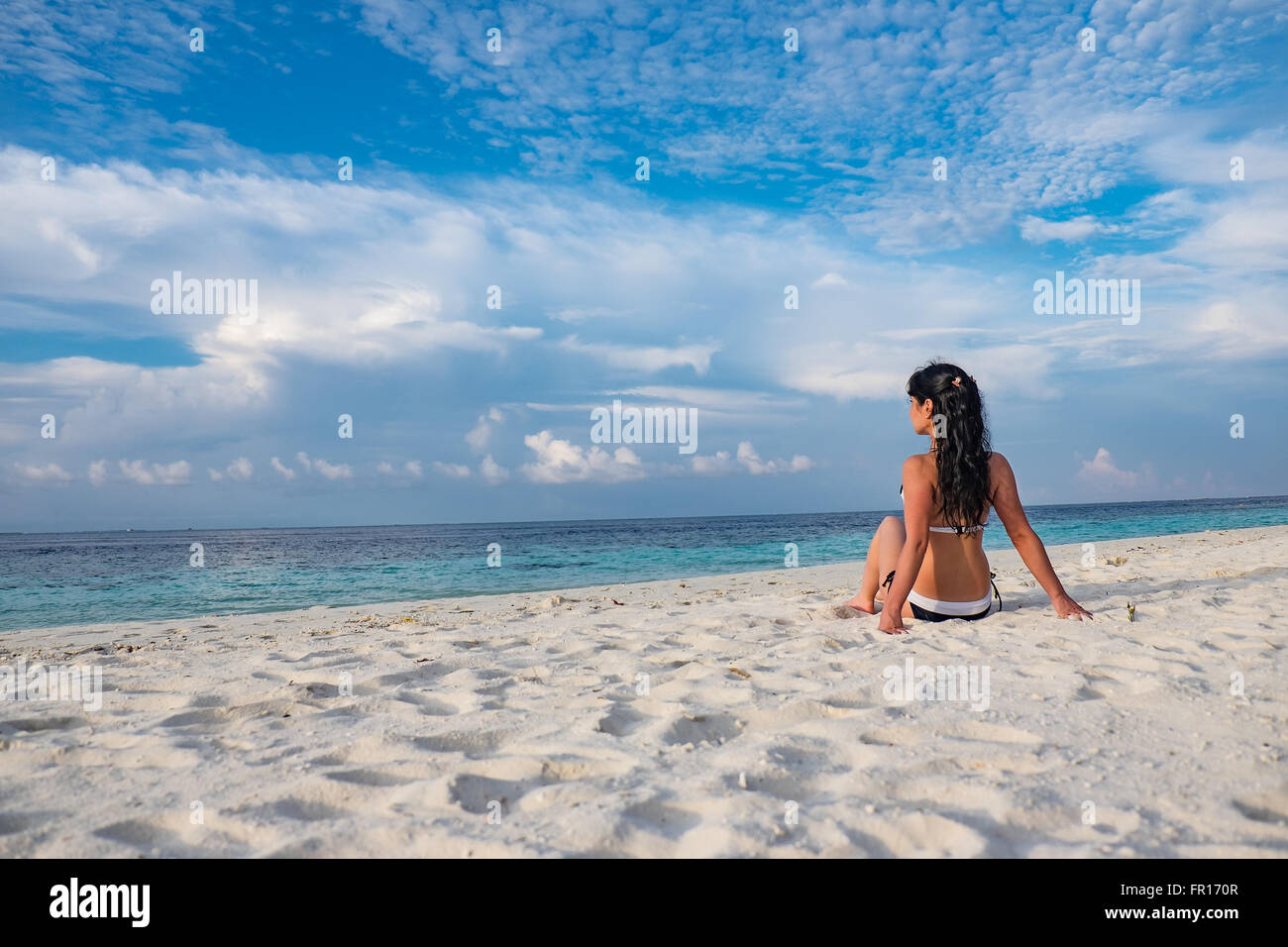 Beach vacation. Girl and tropical beach in the Maldives. - Stock Image