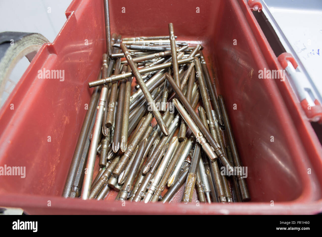 Screwdriver Head Drill Bits rust oil was soaked. - Stock Image