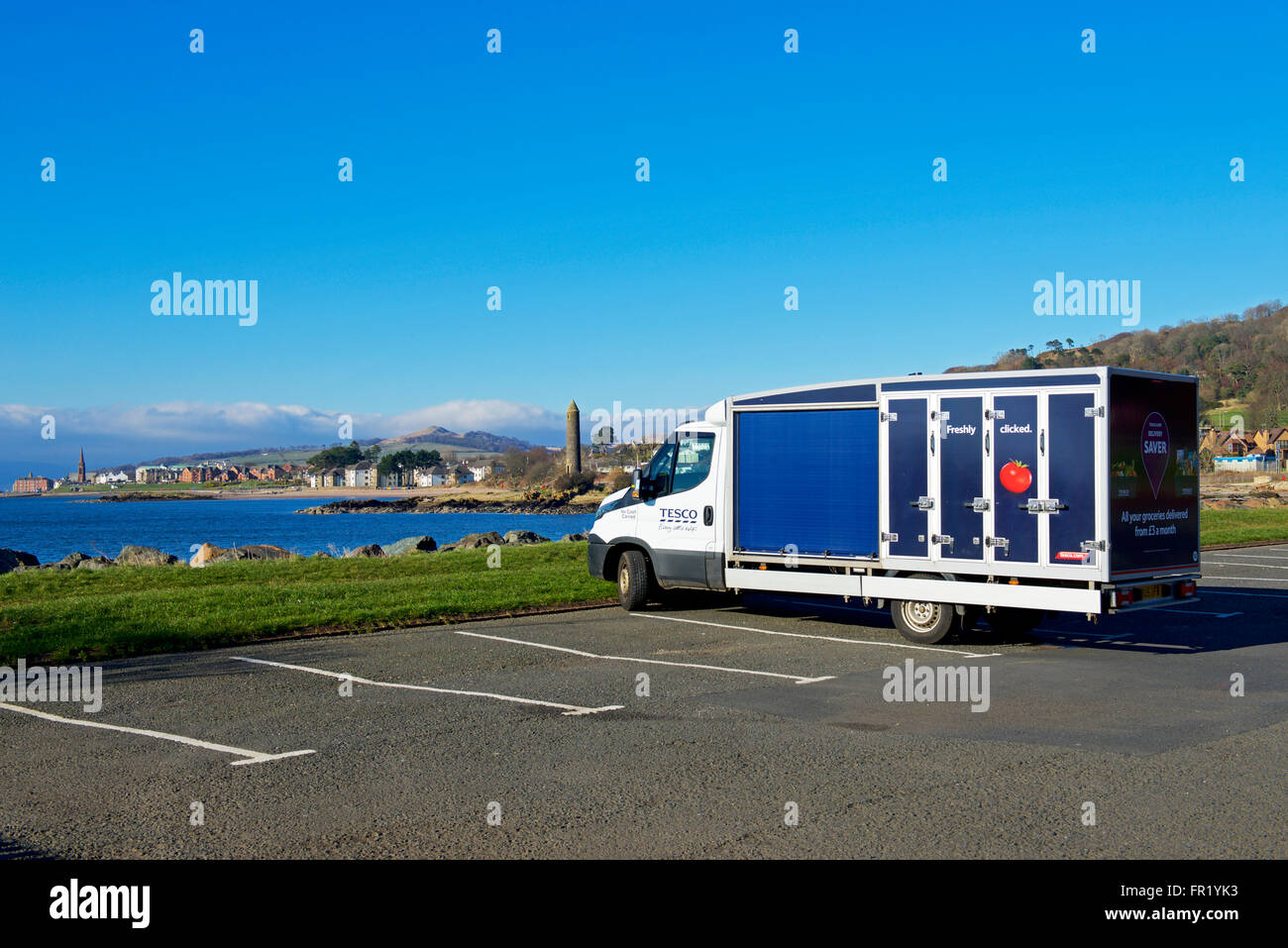 Tesco delivery van, parked overlooking the coastal town of Largs, North Ayrshire, Scotland UK - Stock Image