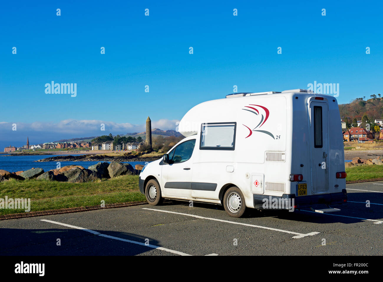 Small motorhome, Romahome 25, parked overlooking the coastal town of Largs, North Ayrshire, Scotland UK - Stock Image