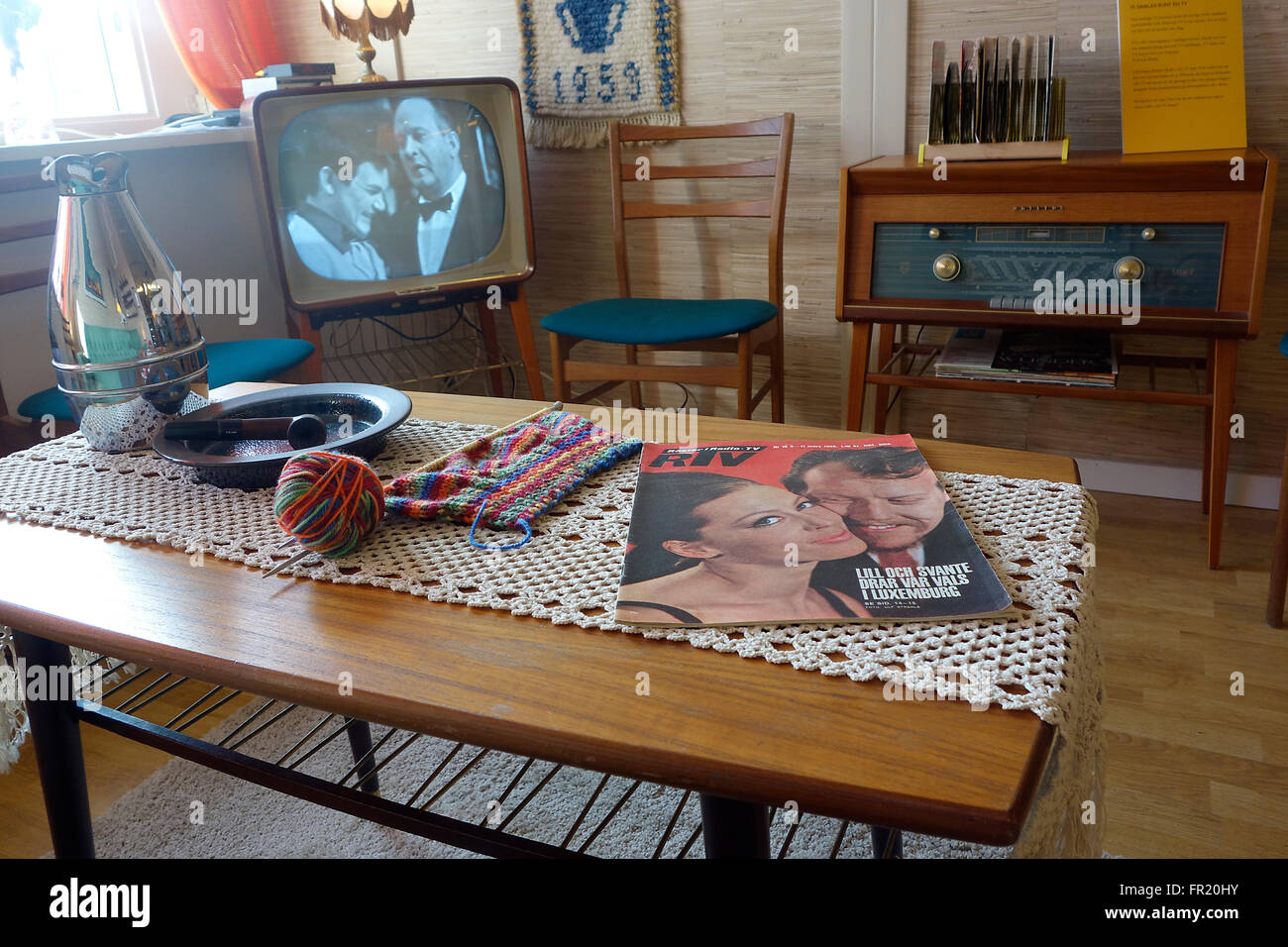 Mid 60es Swedish middle class sitting room with B&W TV and radio receiver set.  Interior design. - Stock Image