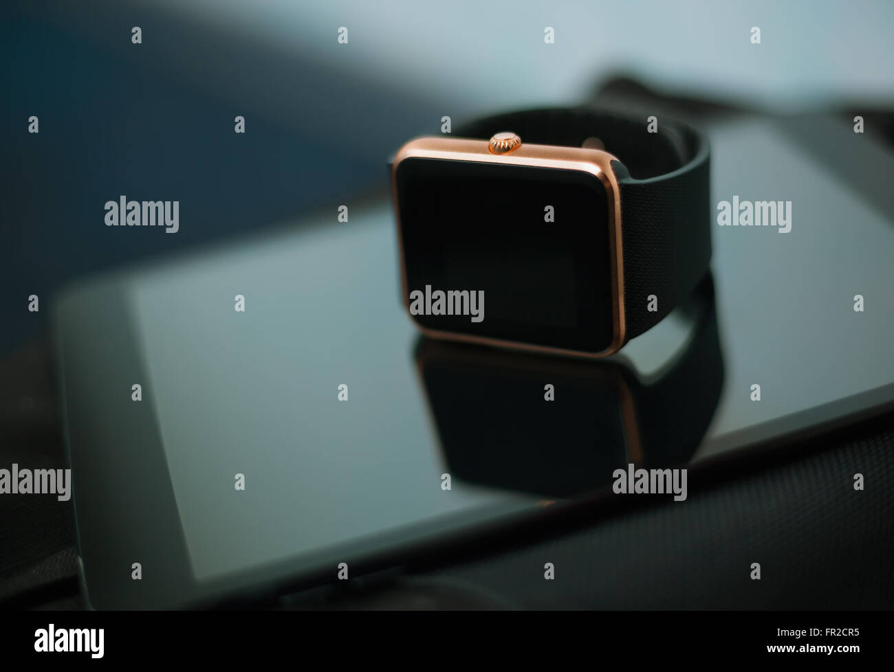 Wearable clever technology of today - smart wrist watch and tablet pc. This digital devices will let you stay connected - Stock Image