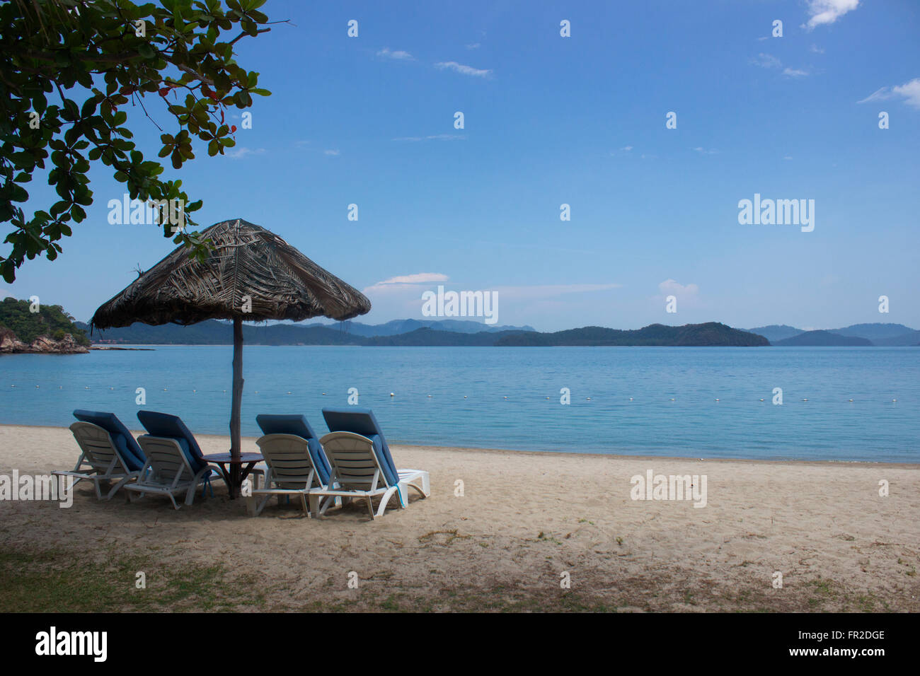 Taj Vivanta Rebak Island Langkawi resort in one of the most beautiful resorts in South East Asia. Laze on the beach - Stock Image