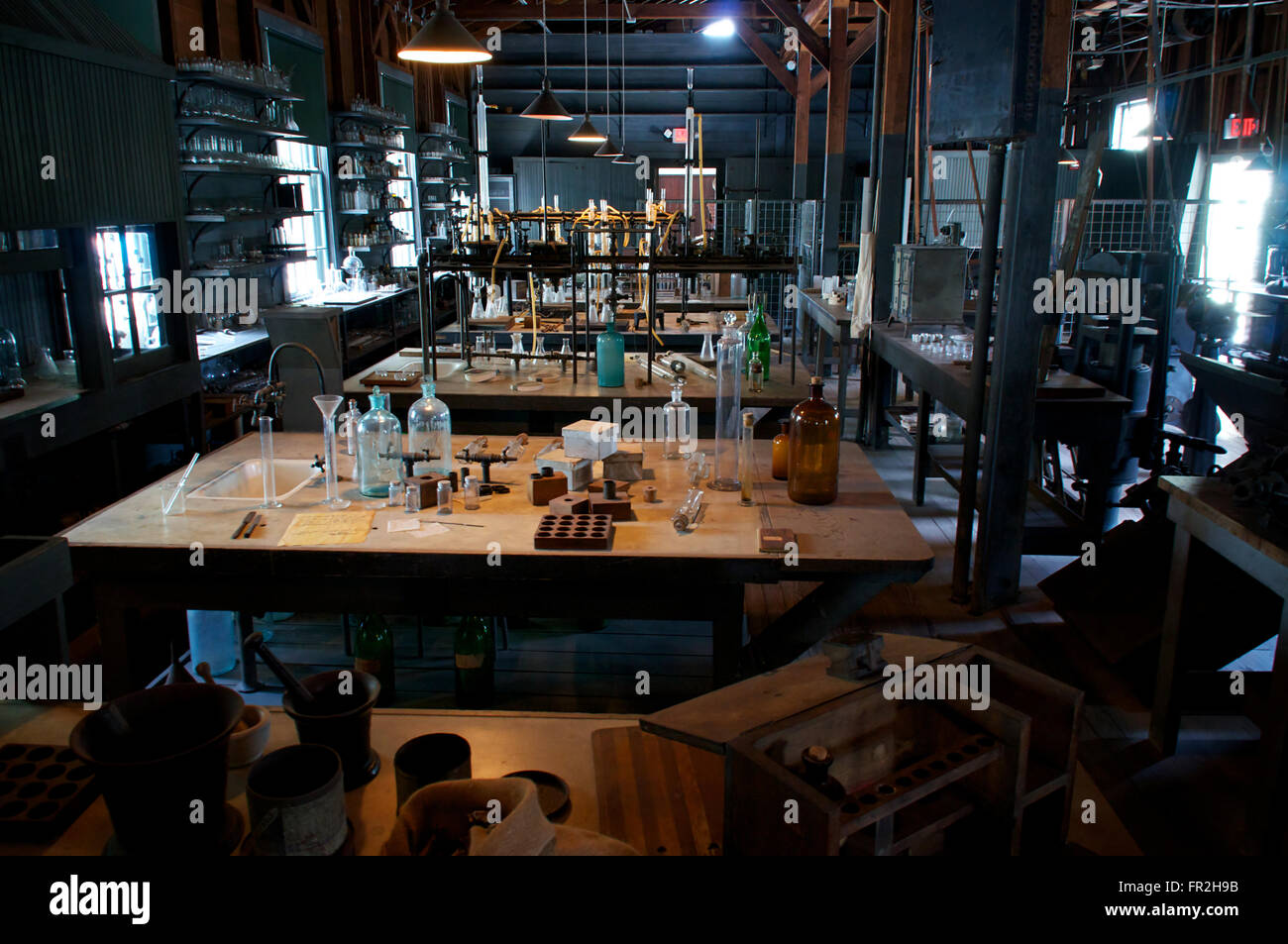An old abandoned laboratory from the early 1900's. with work tables, bottles, beakers. - Stock Image