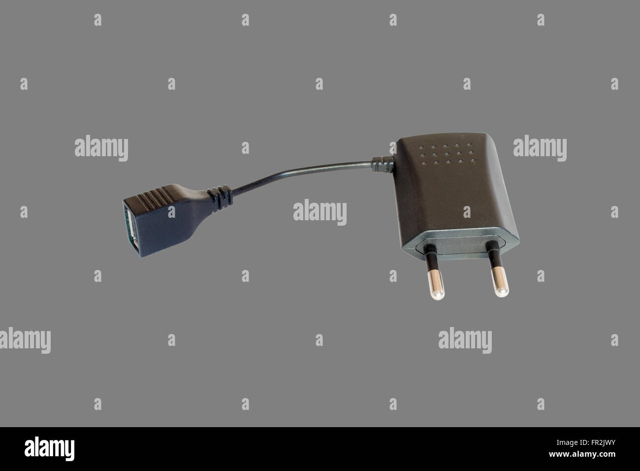 AC adapter with USB. Isolate on gray background - Stock Image