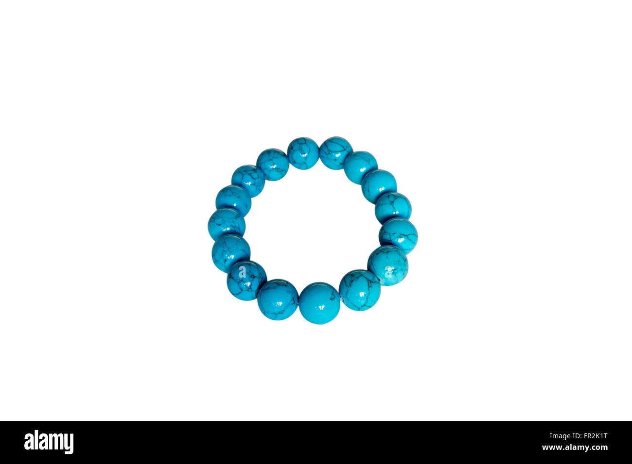 Bracelet made of turquoise. Isolate on white background - Stock Image