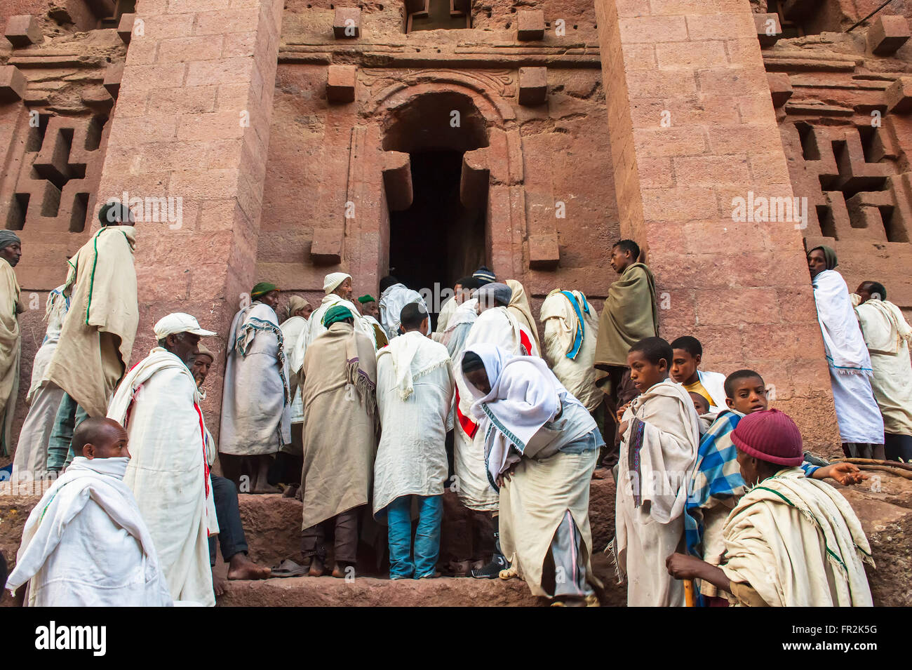Pilgrims with the traditional white shawl attending a ceremony, Bete Medhane Alem church, Lalibela, Ethiopia - Stock Image