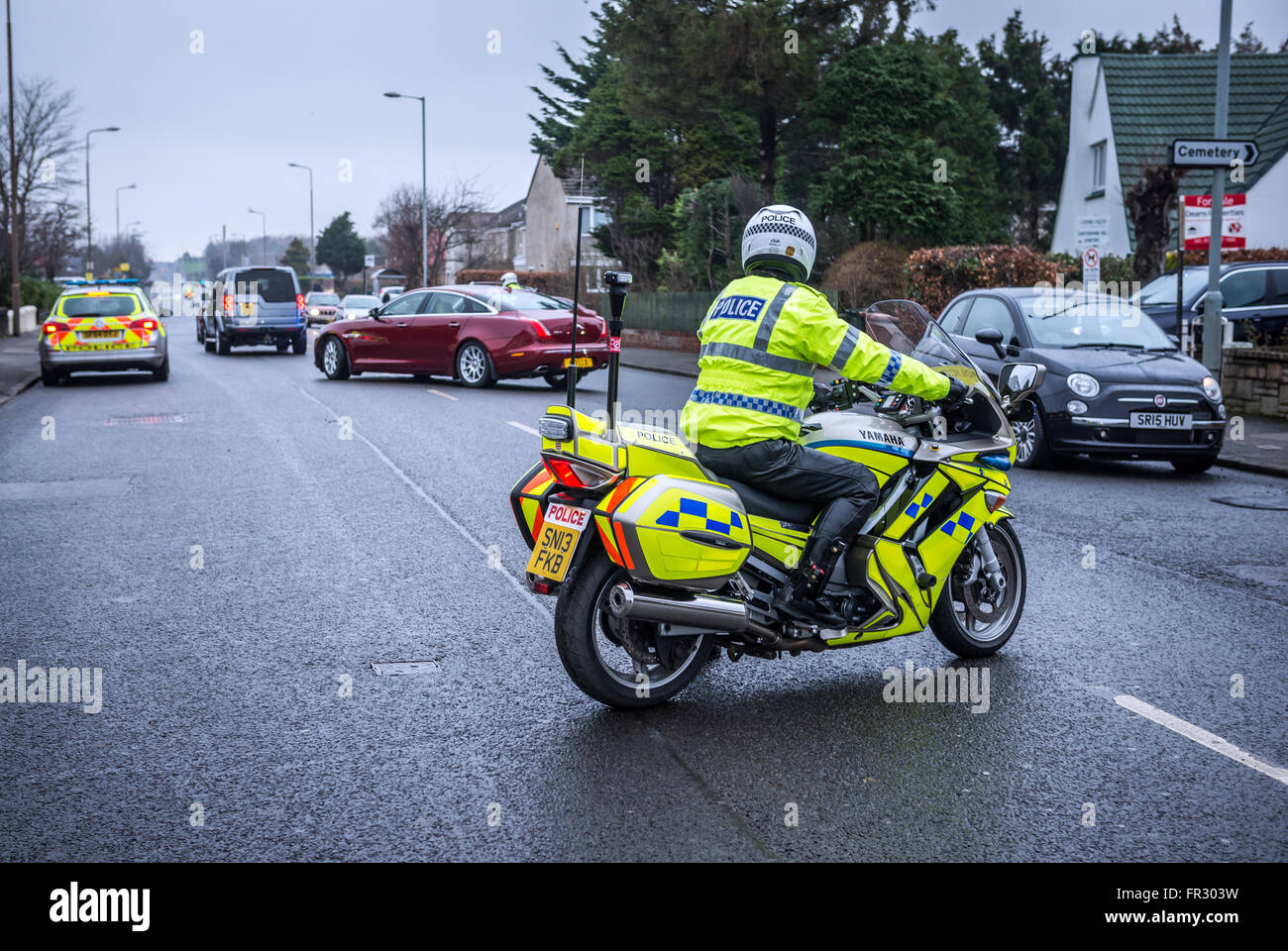 Policeman on motorbike at Drum Brae Street in Edinburgh, Scotland, UK - Stock Image