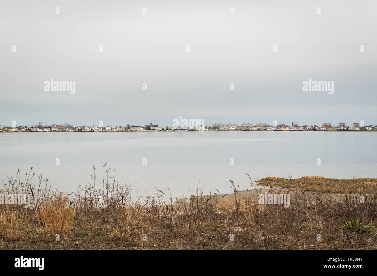 View across Jamaica Bay Wildlife Refuge towards Broad Channel, a suburban waterside town in Queens, New York. - Stock Image