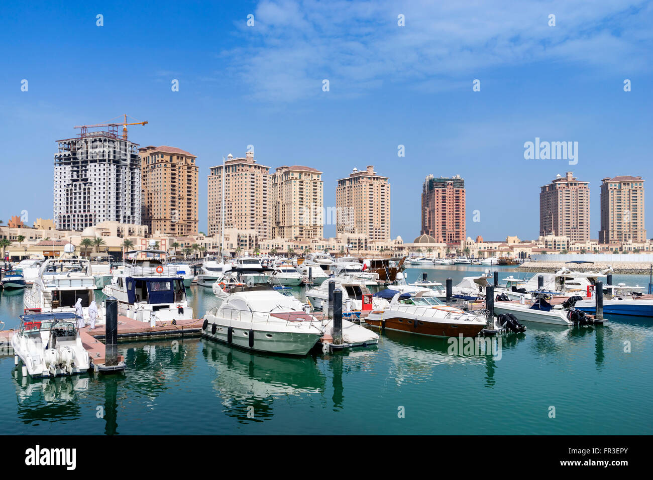 View of marina and apartment buildings at The Pearl luxury new residential property development in Doha Qatar - Stock Image