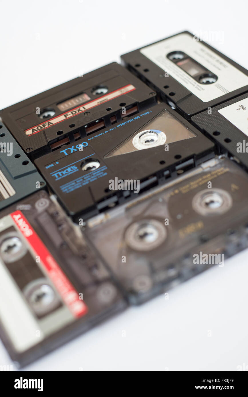Collection of audio cassette tapes isolated on a white background - Stock Image