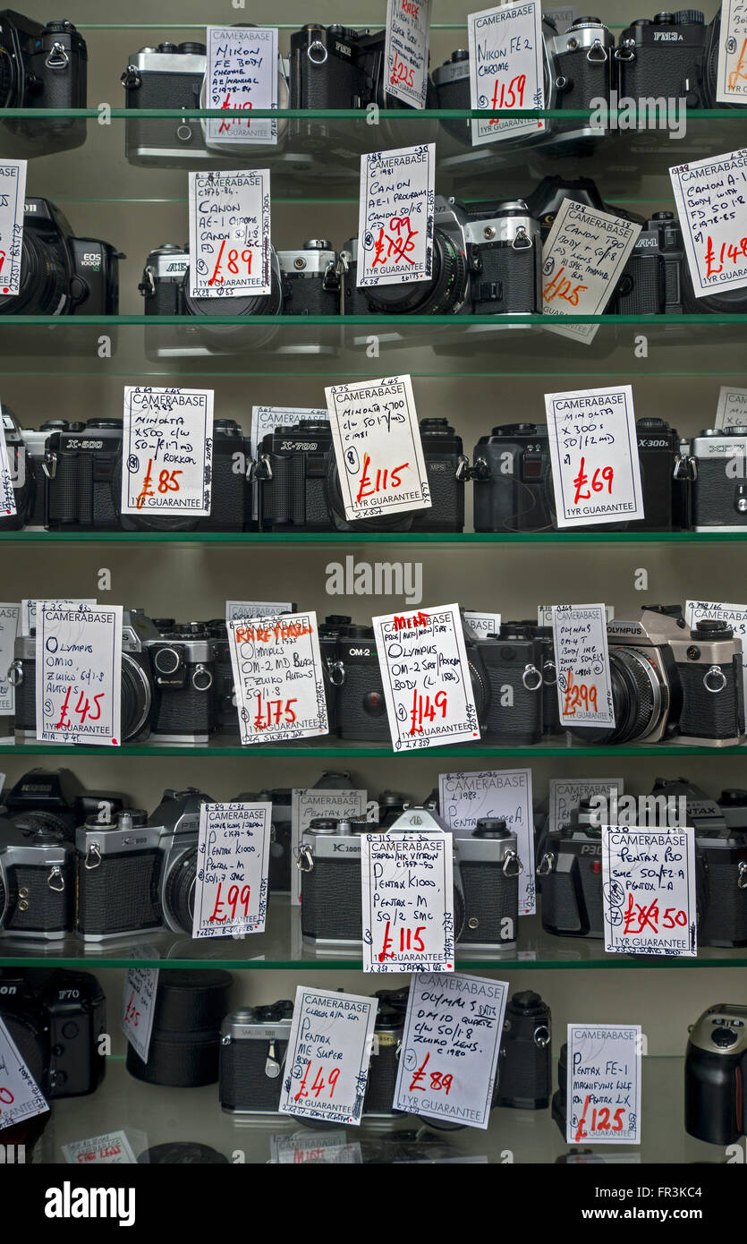 A display of secondhand film cameras in a small independent camera store in Edinburgh. - Stock Image