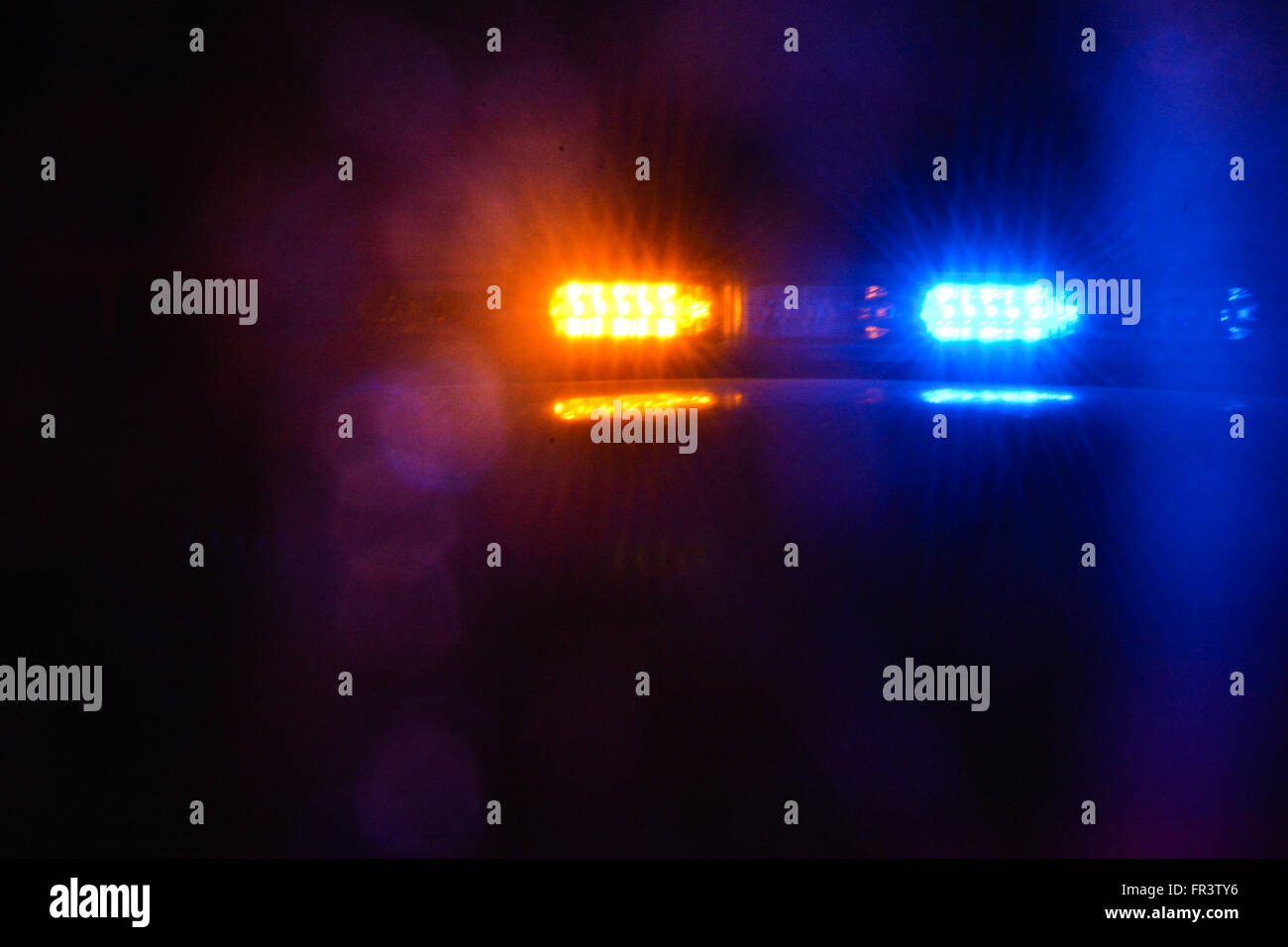 Red And Blue Flashing Police Car Lights Atop A Patrol Car At Night While  Conducting Law Enforcement Business