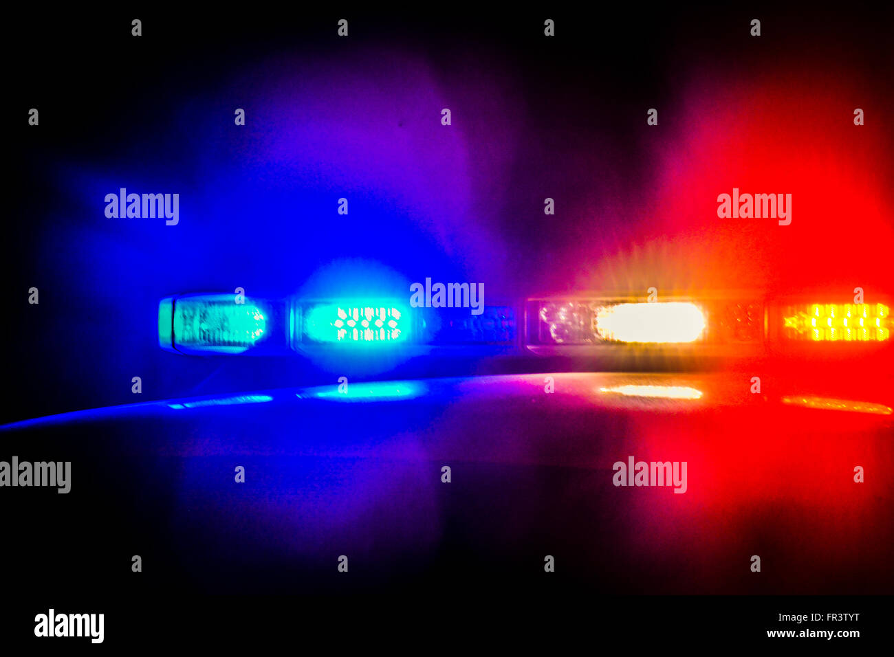 Red And Blue Flashing Police Car Lights Atop A Patrol Car At Night While  Conducting Law Design Inspirations