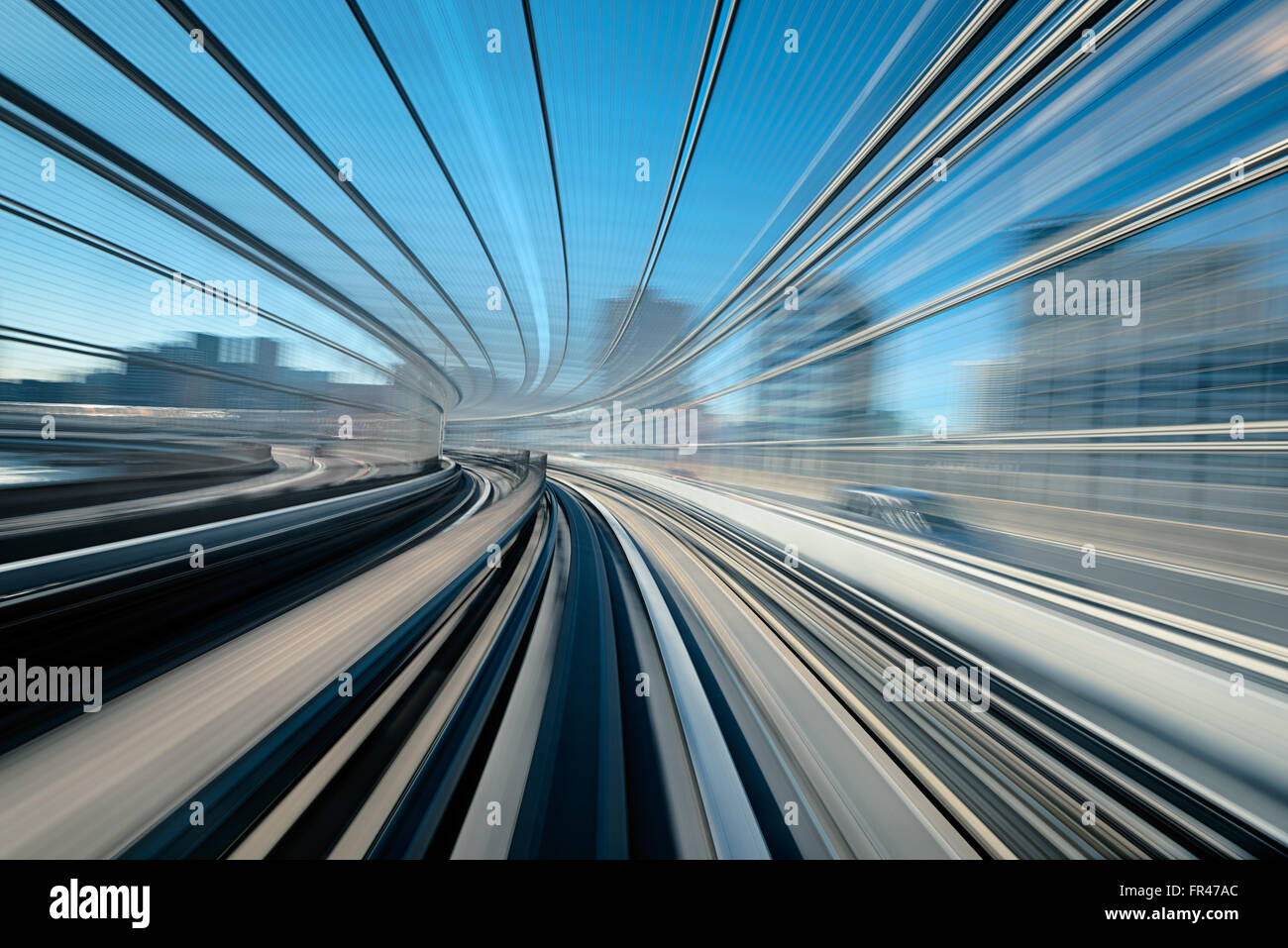 A blurred motion on the railway in Tokyo, Shiodome district. - Stock Image