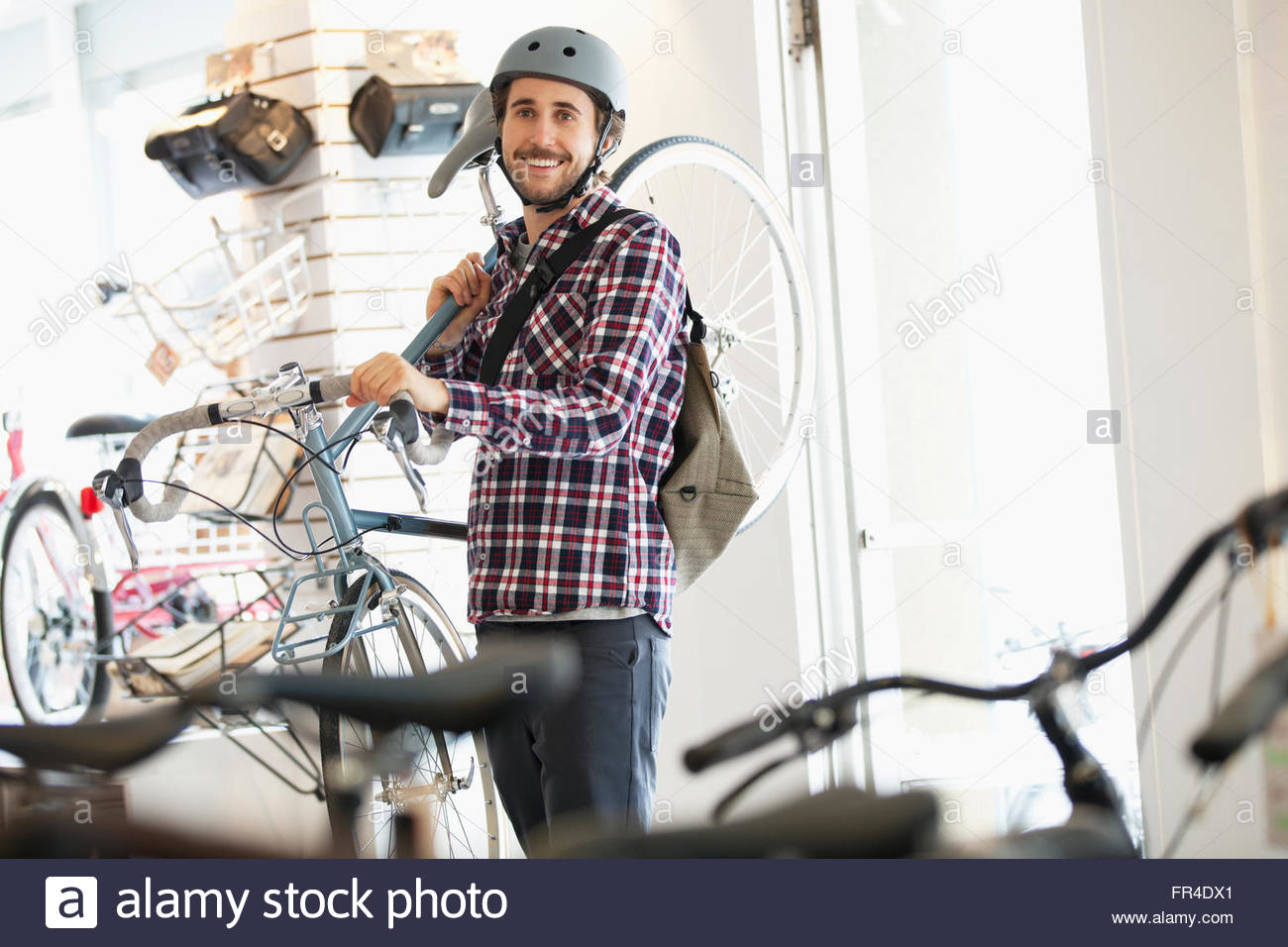 bicyclist at bike shop - Stock Image