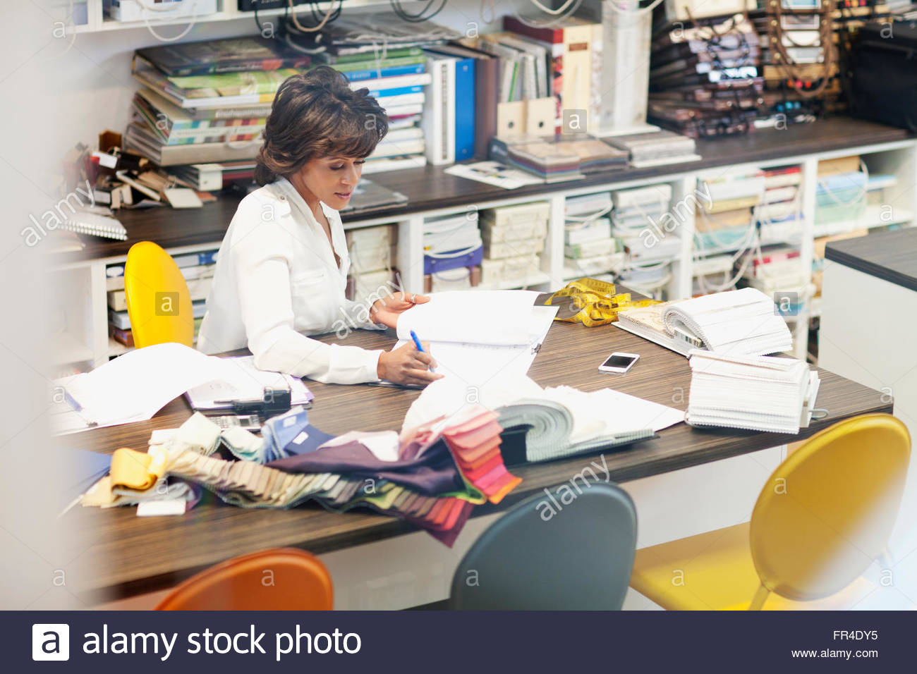 designer doing inventory of stock fabric - Stock Image
