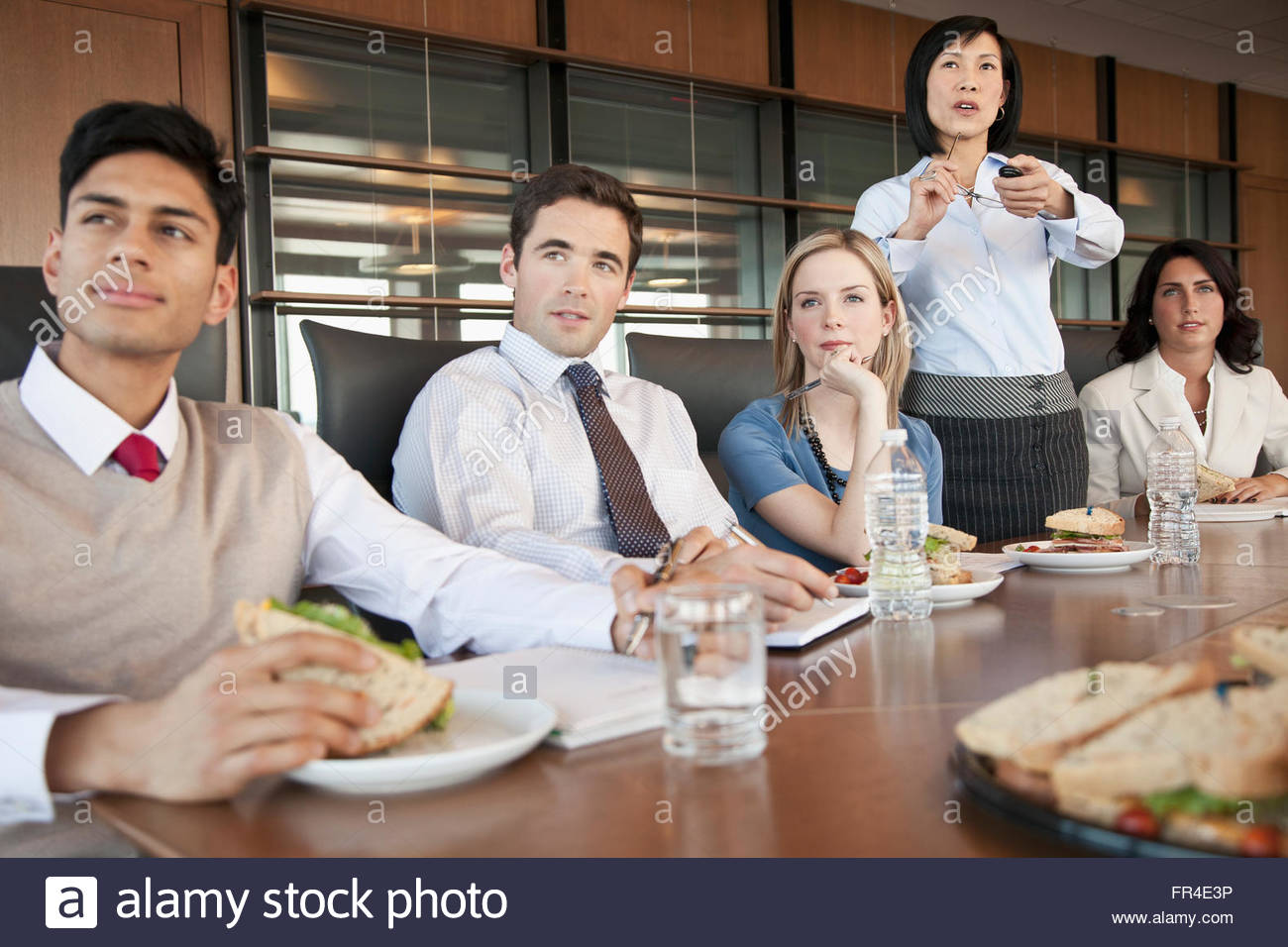 office coworkers at luncheon meeting - Stock Image