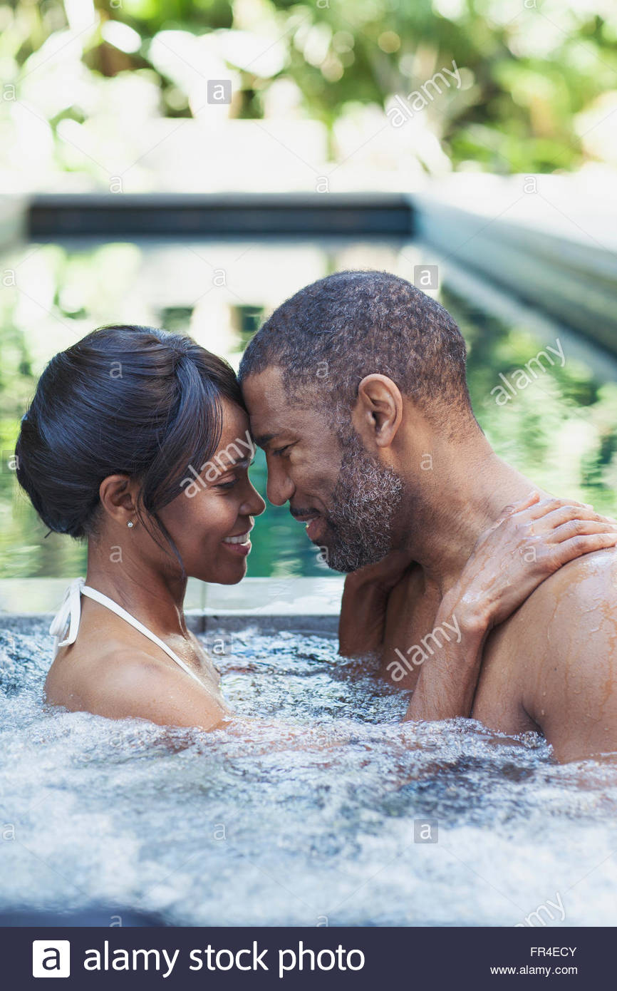 couple getting close in hot tub - Stock Image