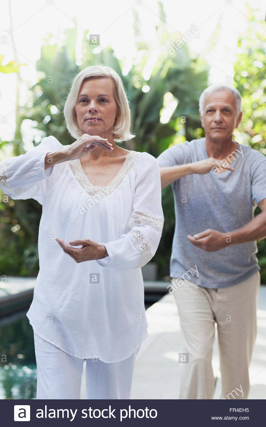senior couple doing Tai Chi together - Stock Image