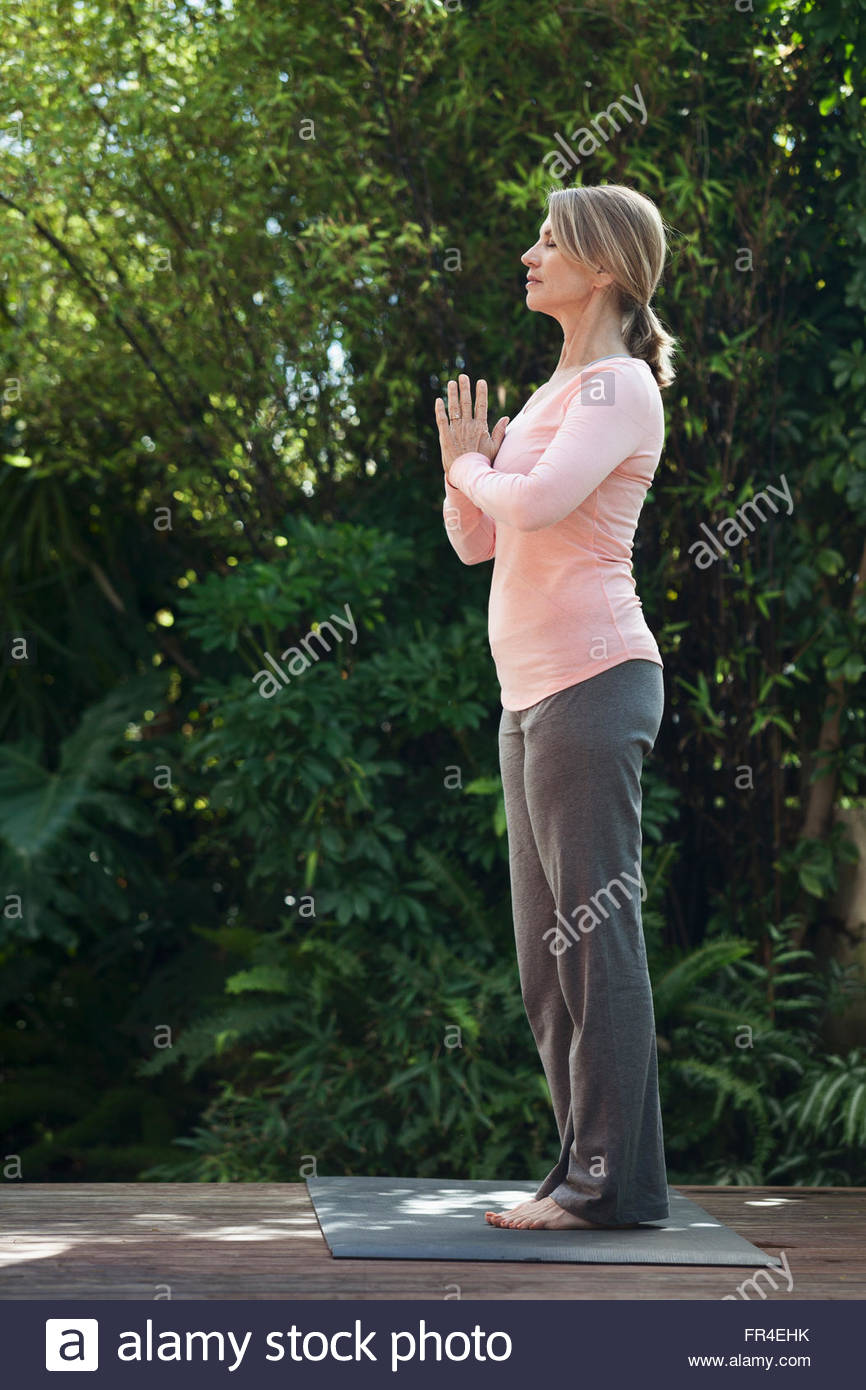 profile of woman in yoga pose Stock Photo