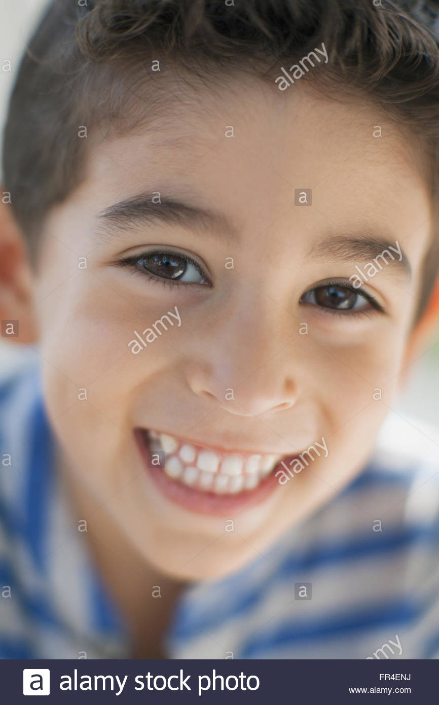close up portrait of young boy with a smile - Stock Image